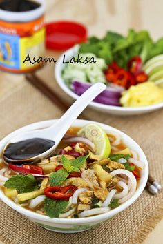 Asam Laksa is a flavorful, tangy, and spicy Malaysian fish based rice noodle soup. It is a dish not to be missed when visiting Malaysia. Laksa Soup Recipes, Laksa Recipe, Noodle Recipes, Malaysian Cuisine, Malaysian Food, Malaysian Recipes, Indian Food Recipes, Asian Recipes, Ethnic Recipes