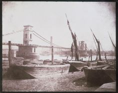 Brunel's Hungerford Suspension Bridge, London, c 1845. Calotype.  Brunel's suspension pedestrian footbridge opened in 1845. It spanned the River Thames from The Embankment to Lambeth and linked London's West End with the South Bank. It was replaced in 1864 by a railway bridge with a pedestrian walkway. Two new footbridges, built on either side of the 1864 bridge and costing £40 million, opened in 2002.