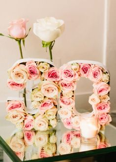 These rose-filled numbers were for a birthday bash but I can  see this design working as wedding table numbers ~ http://www.stylemepretty.com/living/2015/12/29/chic-chanel-inspired-30th-birthday-bash/
