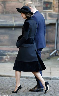 The Duchess paired the fur-trimmed coat with a pair of pointed courts as she joined her husband, Prince William, alongside 1,400 guests to pay their respects