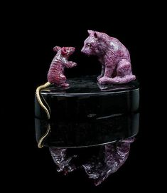 "<b>A Ruby and Obsidian ""Why Can't We Be Friends"" Carving, Luis Alberto Quispe Aparicio,</b> <br  /> Peru, <br  /> consisting of a carved ruby mouse and carved ruby cat standing nose to nose on an obsidian base, both with inset bezeled eye accents, the mouse with a gold vermeil tail. <br  /> 12.06 x 8.25 x 7.62 cm. <br  />"