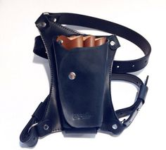 Bag for hairdressing tools. A stylish holster on a belt made of genuine leather. Multifunctional hairdresser Holster for scissors. The device, which allows the master to always have a tool at hand and not be distracted from work. It also provides tools carefully preserved. Bag