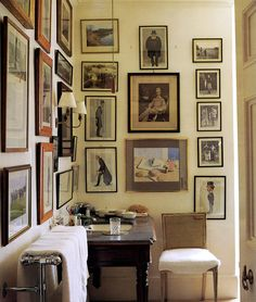 ~Andrew Cavendish's bathroom, off his bedroom, at Chatsworth, with Vanity Fair cartoons by Spy and Ape, and family photographs.  Photo by Simon Upton.