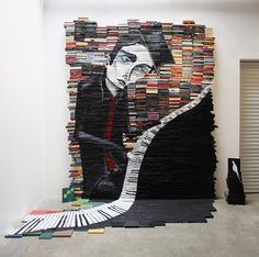 "mikestilkey.com - installations  ""Reminiscent"" June 2010, 12x10 ft. Acrylic on over 2000 books"