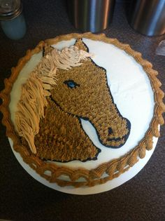 A simpler (and smaller) version of this horse atop a cake with this color scheme.  Horse cake