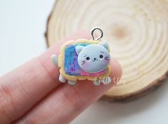 Hey guys here is a galaxy cat biscuithope you like it❤  #galaxy #biscuit #cat #kawaii #kawaiicharms #polymerclay #polymerclaycharms #charms #premo #sculpey #handmade #etsy #etsyseller #etsyfeature #claycharms #cute #cutecharms #clay #miniature #handmade
