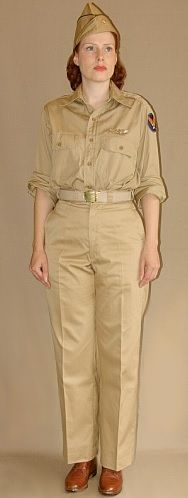 Graduated WASP Summer Uniform. During warm weather, graduated WASP wore khaki shirt and khaki trousers. A men's khaki garrison cap with gold-black officer's piping could be worn with this outfit. The Army Airforce General Headquarter's patch was sewn on the upper left sleeve and the WASP wings were worn above the left breast pocket. Female Marines, Female Soldier, Women Marines, Ww2 Uniforms, Military Uniforms, Air Force Women, Garrison Cap, Secret Photo, Khaki Shirt
