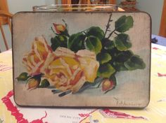 I Found a solid wood hand painted and signed shabby chic rose painting for $2.00 another good find