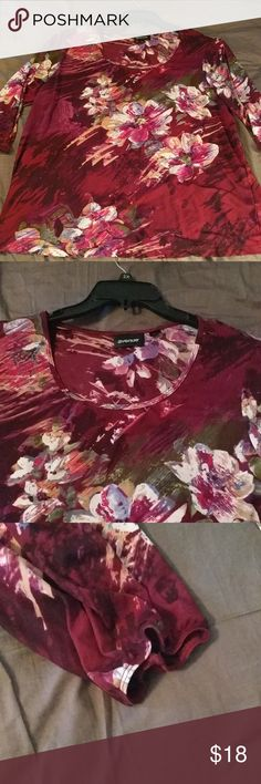 Floral blouse Dark burgundy and purple with white, green, lilac and pink floral pattern blouse with 3/4 length sleeves with elastic at end. Semi sheer. Fabric content in last pic. Gently used. 22/24 Avenue Tops Blouses