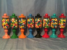 Gum ball jars are made with a glass base and glass jar.