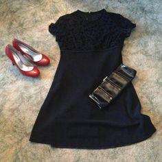 Black dress. Black cocktail dress with sheer top that has flower detailing. Dresses