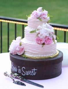 3 tiered round wedding cake -  champagne colored icing with horizontal rustic blading - Top Tier Wedding Cakes - Medford, Oregon