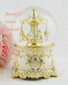 Purple-Rain-Forest-music-box-snow-globe-golden-carousel-horses