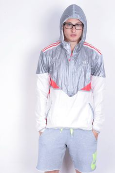 For sale Adidas Mens L Shiny Jacket, impressive.Model wears a size L or XL and have 185cm height.  Material:100% Nylon  Condition:5+/6 Dimensions: inches /