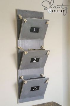 Break out your drill and basic construction skills to DIY this inventive faux-metal magazine rack. Whitney and Ashley of Shanty 2 Chic spray-painted wood in a satin granite color to mimic the look of aluminum and built the bins with hinges, cup hooks, and sisal rope. Chalkboard paint squares on the front of each bin serve as labels. Get the tutorial at Shanty 2 Chic. - CountryLiving.com