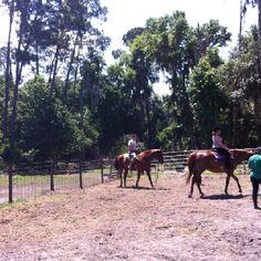 Lou & Sera riding.