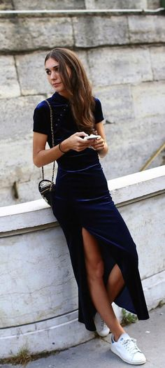 Navy blue crushed velvet slit dress with white Adidas Stan Smith sneakers
