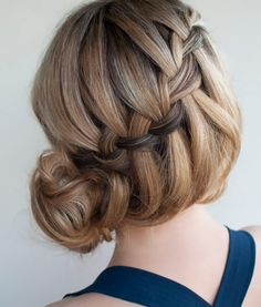 This braided bun would be perfect for a wedding.