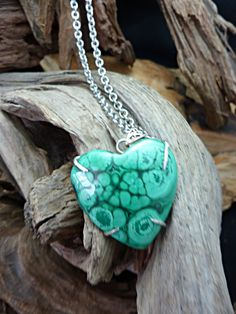 Beautiful Heart of Malachite, Covered with Orbs and set in Sterling Silver Setting