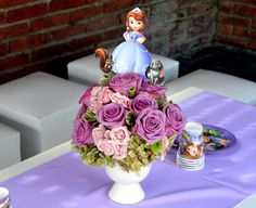 Pretty flower arrangement at a Princess Sofia the First birthday party! See more party planning ideas at CatchMyParty.com!