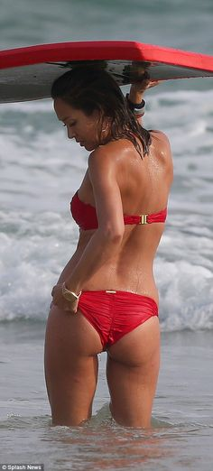 Beach babe:Myleene Klass, 38, appeared to be having a whale of a time during her exotic getaway, as she was spotted enjoying a spot of body-boarding in Sri Lanka