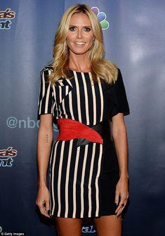 Leggy lady: The 42-year-old star strut her lean legs in a striped mini dress...