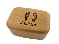 Your baby's foot prints on a jewelry box.  Could also be used to say lock of hair or baby teeth. (http://bluegiraffeboutique.com/products/small-keepsake-box-with-your-loved-ones-actual-foot-print.html)