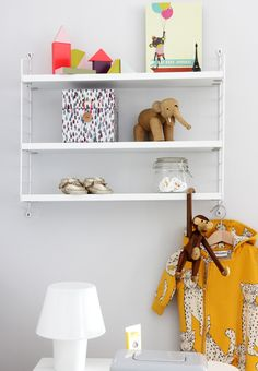 String shelf with a wooden elephant and monkey from Rosendahl via Ohhh Mhhh.