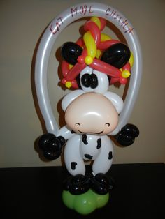 Chick fil a cow wearing balloon hat