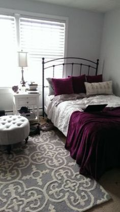 Dark Hued Gray Rug Fluffy With Maroon White Pillows And A Duvet