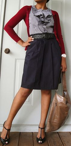 Red cardigan. Sleeveless gingham ruffle front shirt. Navy semi- A-line Skirt. T-strap heels.