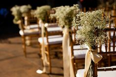 -WANT THIS AS THE AISLE RUNNERS  Baby's breath tied to chairs lining the aisle. I like this for the aisle decor, I especially like the ribbon.