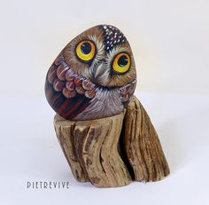 Owl hand painted on a river stone. One of a kind by LivingRocks