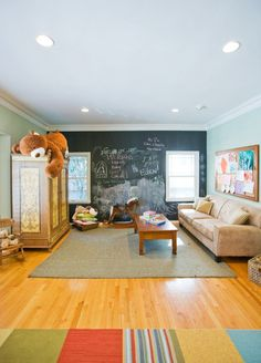 Fun and functional family play room. Love the chalkboard wall. #chalkboard #playroom