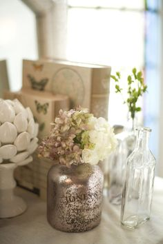 I like the eclectic mix of white, glass, and silver/pewter for vases.