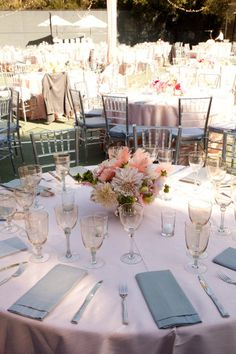 Lovely pastel flowers, champagne tinted glassware make a gorgeous light colored wedding reception
