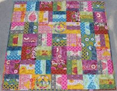 i don't usually like rail fence quilts, but making it in modern fabric and including a few unpieced blocks looks amazing (izzy inspired: peace quilt)