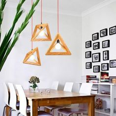 Dining room with wood art suspended pendant lights.