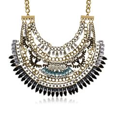 This fantasy necklace is adorned with created opal, black onyx, aquamarine and clear crystals throughout the entire necklace.  Bib measures 6 inches wide and 3 inches long.