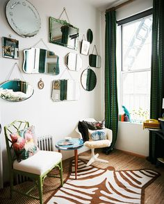 green curtains + wall of mirrors