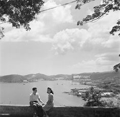 A couple sit and watch the boats in Charlotte Amalie, St. Thomas, US Virgin Islands.