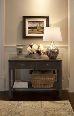 Traditional foyer with light gray walls paint color paired with white wainscoted walls. Bungalow 5 Harlow Console Table in Taupe with mercury glass lamp, taupe lacquer tray, wicker basket and foyer flowers.