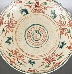 A SWATOW IRON-RED AND TURQUOISE ENAMELLED BOWL MING DYNASTY, 17TH CENTURY  the central medallion with the characters for 'peerless' surrounded by the ten celestial stems and horary signs all within a broad band with leaping carp among stylised waves  35.5cm., 14 in.