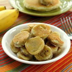Banana medallions are lightly coated in pancake batter and browned on a griddle. These will rock your breakfast routine!