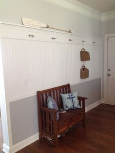 Our bead board wall: half vertical, half horizontal painted darker with nautical cleat hooks!