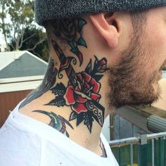 Rose And Dagger Neck Tattoo   http://tattoos-ideas.net/rose-and-dagger-neck-tattoo/