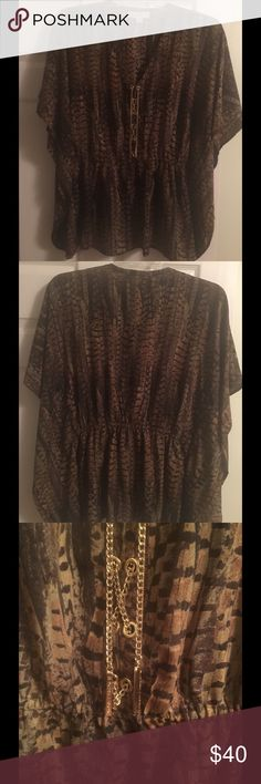 MICHAEL Michael Kors Kimono Top Michael Kors kimono sleeve top  Pre-loved condition MK top with golden chain detail on neck. Fits beautifully on waist and falls perfectly. Look when great paired with short skirt or leggings Michael Kors Tops Tunics