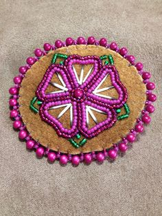 Red/Purple flower with porcupine quills pin by Alaska Beadwork.