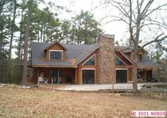 3 bd/3 bth large cabin on 31+ acres!!! Log construction, but LOTS of windows!