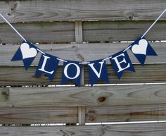 Love Banner in Navy Blue and White by craftyearth on Etsy, $10.50. Would ask for hearts in red.